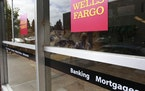 An advertisement for home mortgages is shown at a Wells Fargo Bank in Menlo Park, Calif., Thursday, July 8, 2010. Mortgage rates fell for the second s