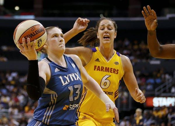 Lynx point guard Lindsay Whalen drove to the basket past Los Angeles' Jenna O'Hea.