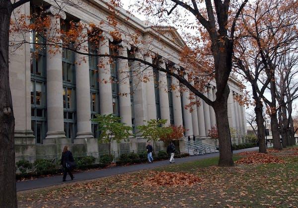 Students walk through the Harvard Law School area on the campus of Harvard University in Cambridge, Mass.