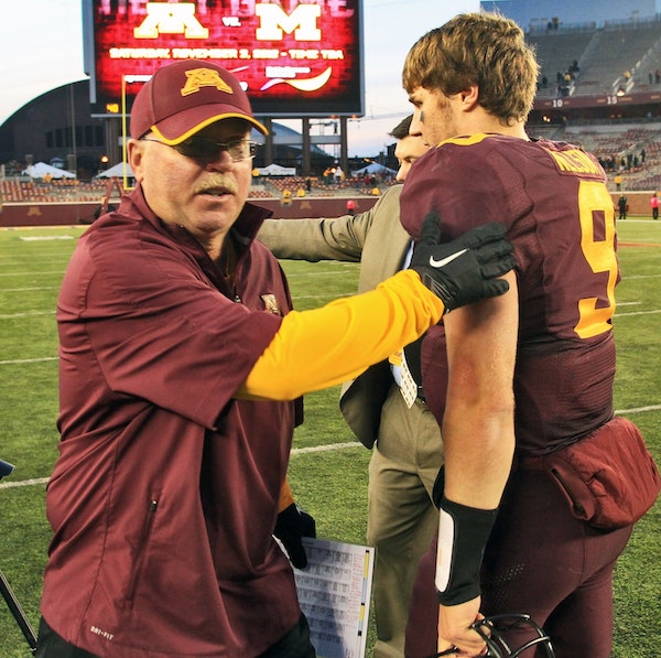 Gophers football coach Jerry Kill congratulated quarterback Philip Nelson at the end of Minnesota's 44-28 victory over Purdue on Saturday.