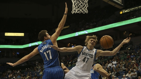 Andrei Kirilenko was fouled going to the basket by the Magic's Josh McRoberts.