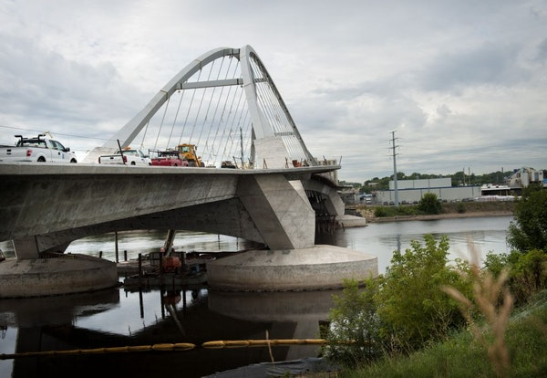 When the new Lowry Avenue Bridge opens, businesses on both sides of the Mississippi River are anticipating better times for their bottom line.