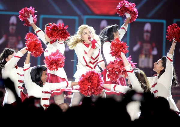 """At her Saturday night performance at the X, Madonna dressed up in her majorette outfit and sang her anthem, """"Express Yourself."""""""