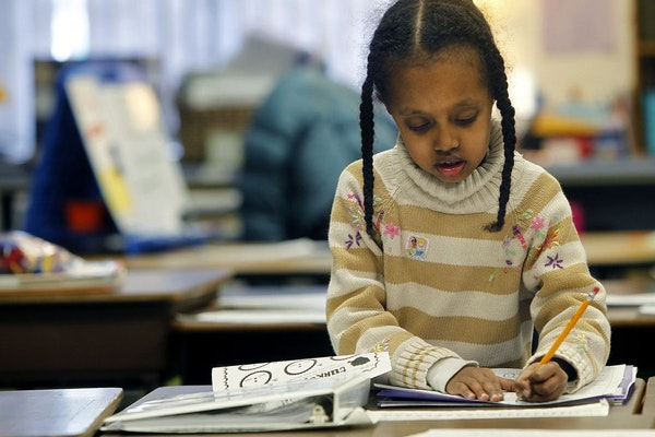 First-grader Nabat Bakri worked on her assignment Tuesday at Otsego Elementary School.
