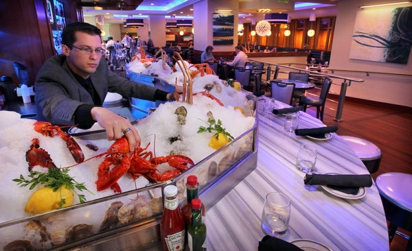 General manager Jake Uttich at the raw bar at the Oceanaire Seafood Room, which moved to well-situated quarters at 6th Street and Nicollet Mall in Min