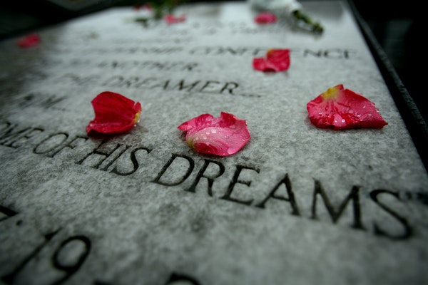 File photo: Rain soaked rose petals laid on plaque at the Lorraine Hotel in Memphis where Martin Luther King was assassinated.