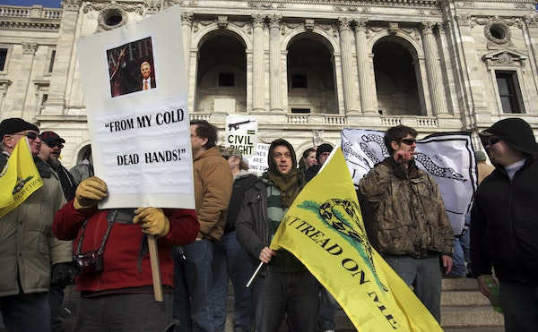 Second amendment supporters stood on the steps during the Capitol rally to protest new gun control legislation Saturday, Jan. 19, 2013, in St. Paul, M