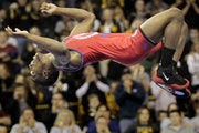 Known as the flying squirel, Ellis Coleman does a flip after clinching a spot on the U.S. Olympic Greco-Roman wrestling team.