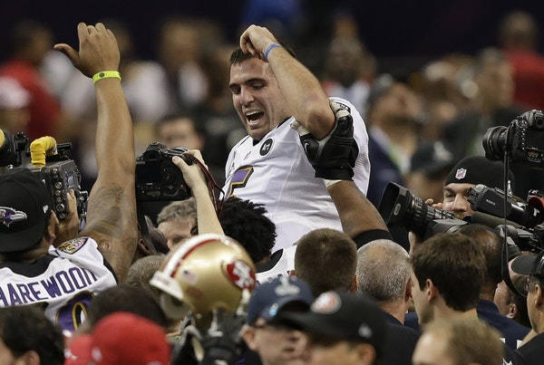 Baltimore quarterback Joe Flacco (5) was lifted into the air by teammates after defeating San Francisco 34-31 in Super Bowl XLVII.