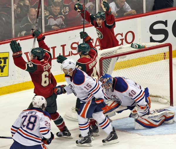 Wild players began the celebration after Charlie Coyle, left, beat Oilers goalie Devan Dubnyk for a goal.