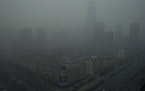 Skyscrapers are obscure by heavy haze in Beijing Sunday, Jan. 13, 2013.