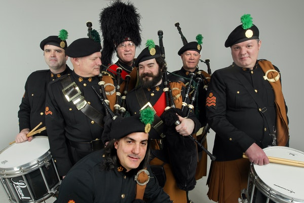 Members of the Brian Boru Irish Pipe Band, standing from left: Dermot Gallagher, Mike Faricy, Jim Tarbox, Jimmy Sherman, Jim Burke and Rick Blevins. I