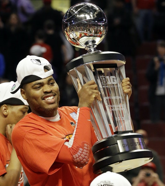 Ohio State forward Deshaun Thomas (1) holds up the Big Ten Championship trophy after an NCAA college basketball game against Wisconsin in the champion