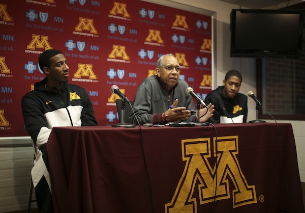Flanked by Austin Hollins, left, and Rodney Williams, Jr., right, Head Coach Tubby Smith answered a question during the news conference. The Universit