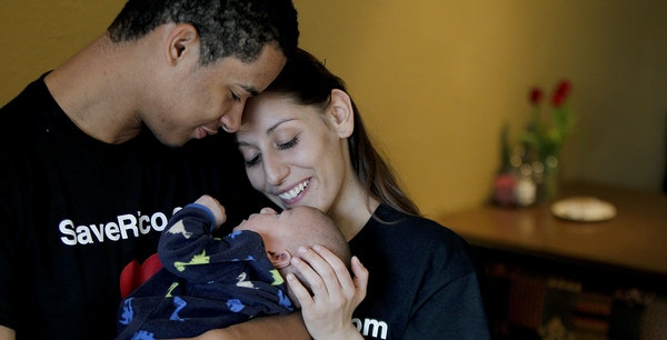Parents John Martinez and Lindsey Nagel greeted their son Rico at home in Brownsdale, Minn.