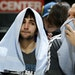 Ricky Rubio, left, and Greg Stiemsma sat on the bench in the final minutes of the Wolves' 96-80 loss to Utah in the team's final home game of the