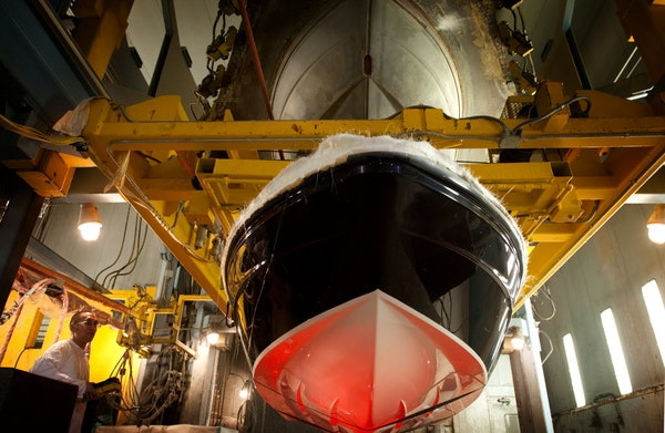 Justin Meidl worked on a Larson boat hull at the Larson Boat Group's plant in Little Falls, Minn., in 2013. The plant's closing and consolidation in