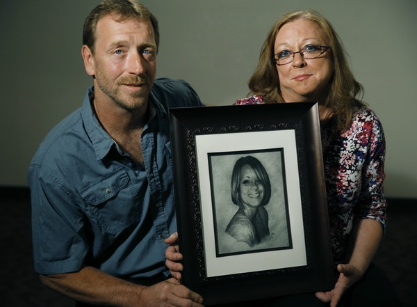 Kira Trevino's parents, Jay and Marcie Steger, hold a sketch of their daughter.
