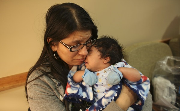 Christina Alonzo was reunited with her 2-month-old son, Elijah, at Maple Grove Hospital Tuesday night.