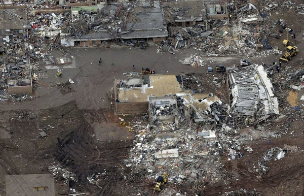FILE - A Tuesday, May 21, 2013 file photo, an aerial view shows Plaza Towers Elementary School, which was destroyed in Monday's tornado, in Moore, Okl