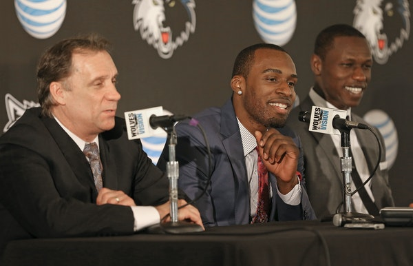 Wolves President Flip Saunders, left, formally presented the team's 2013 first-round picks, Shabazz Muhammad and Gorgui Dieng, on Friday at Target C