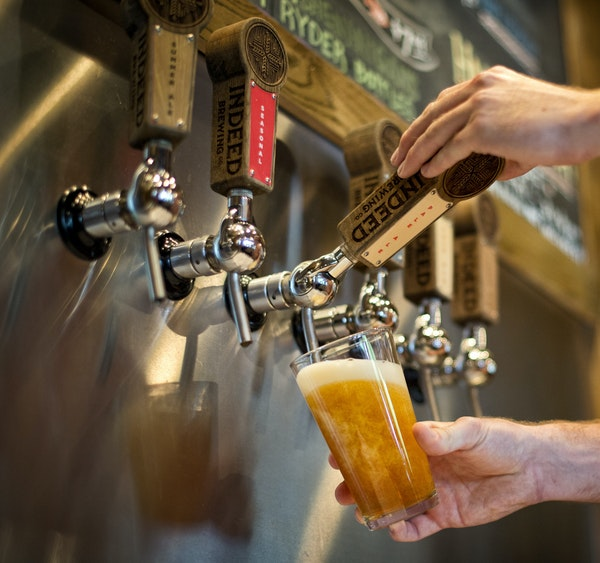 Tom Whisenand, co-founder of Indeed Brewing Co. of Minneapolis, poured a glass of Indeed pale ale.