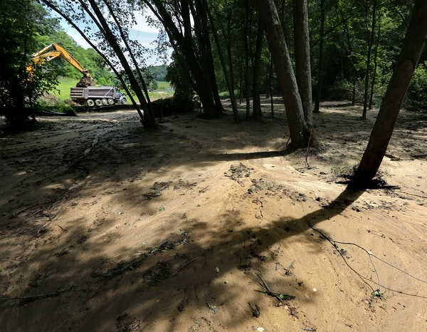 Waste piles at Preferred Sands in Blair, Wis., have twice absorbed enough water to turn lava-like and spill onto neighboring property.