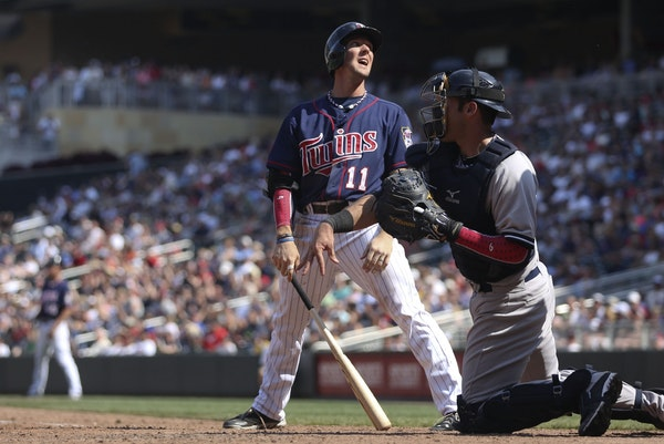 The Twins' Clete Thomas reacted after being called out on strikes in the eighth inning against the Yankees at Target Field on Thursday in a 9-5 defeat