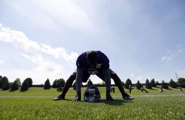 Minnesota Vikings receiver Greg Jennings (15) stretched out during practice on Wednesday.