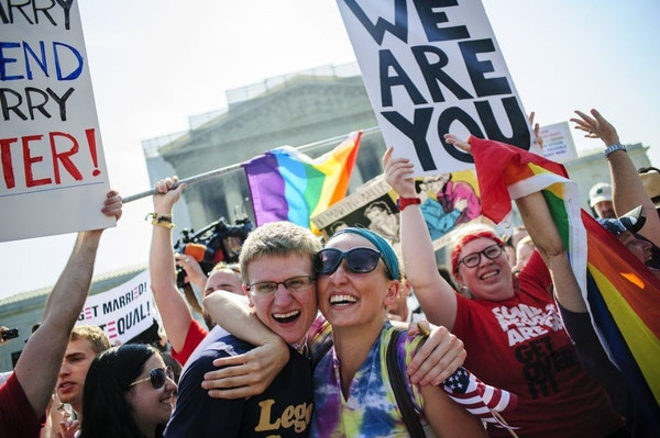 Supporters of same sex marriage celebrate outside the Supreme Court after hearing that the Court struck down the Defense of Marriage Act, Wednesday, J