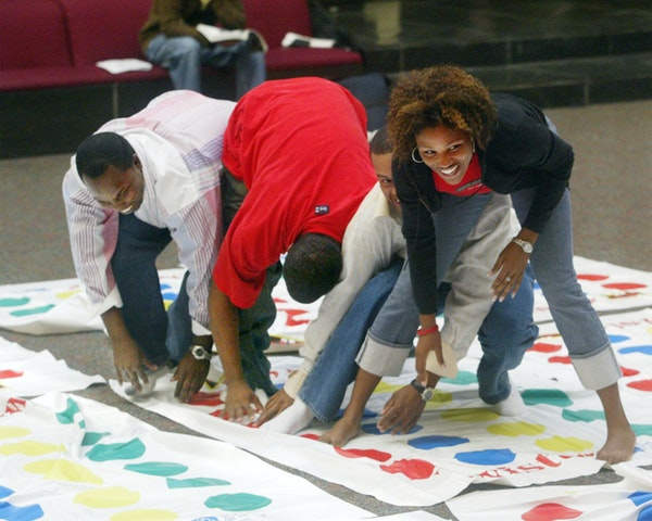 """In this file photo, people play Twister in Edwardsville, Ill. Charles """"Chuck"""" Foley, inventor of the iconic Twister game, died Monday, July 1, 2013, a"""