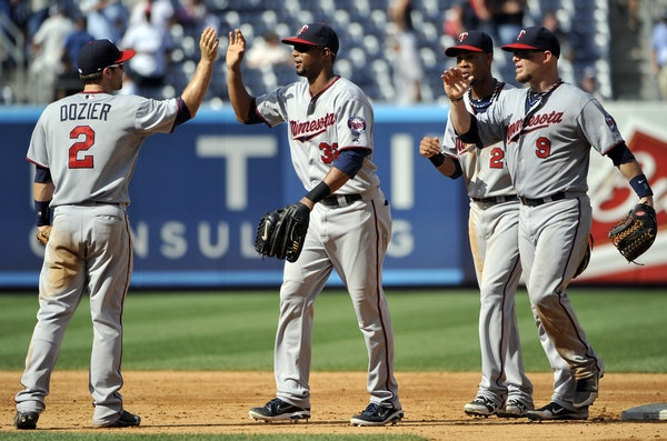 Minnesota's Brian Dozier (2), Aaron Hicks (32), Pedro Florimon (25) and Ryan Doumit (9) celebrate a 10-4 win over the New York Yankees.