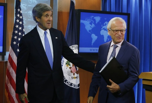 Secretary of State John Kerry stands with former U.S. Ambassador to Israel Martin Indyk at the State Department as he announces that Indyk will shephe