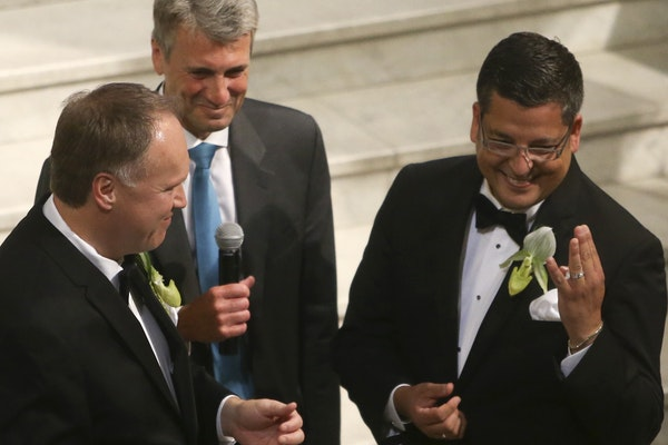 Al Giraud and Jeff Isaacson during their wedding ceremony at City Hall in Minneapolis.
