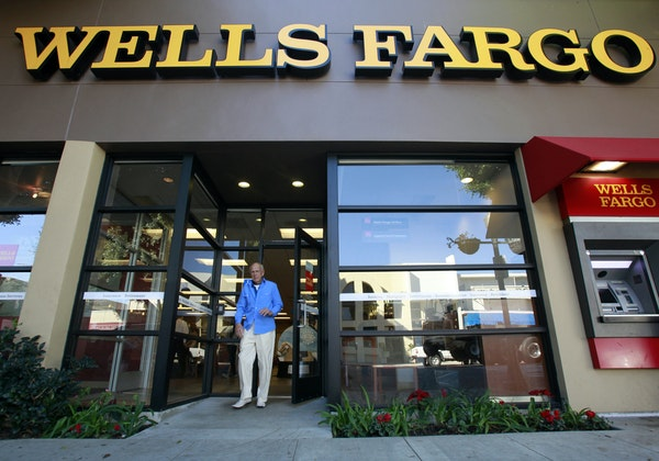 FILE - In this Jan. 18, 2011 file photo, a customer exits a Wells Fargo bank branch in Los Angeles. Are banks strong enough to spare some cash? The co