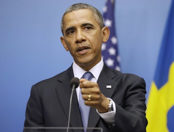 President Barack Obama gestures during his joint news conference with Swedish Prime Minister Fredrik Reinfeldt, Wednesday, Sept. 4, 2013, at the Rosen