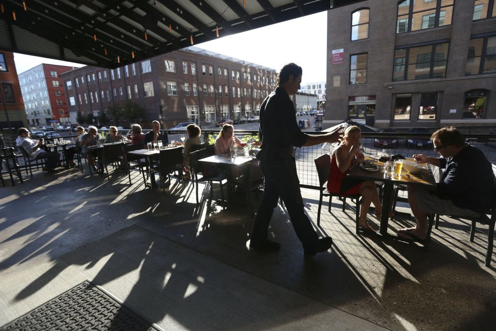 People eating on the patio at Borough restaurant, located in the North Loop, in 2013.