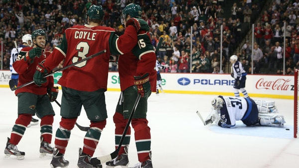 Charlie Coyle celebrated after scoring the second Wild goal during the first period Saturday at Xcel Energy Center.