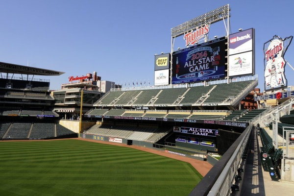 A message showing that the Minnesota Twins will host the 2014 All-Star game at Target Field displays on an outfield video screen after Commissioner Bu
