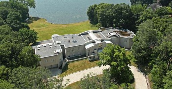The house, almost 23,000 square feet, is set on 3.5 acres with 296 feet of Lake Minnetonka shoreline.