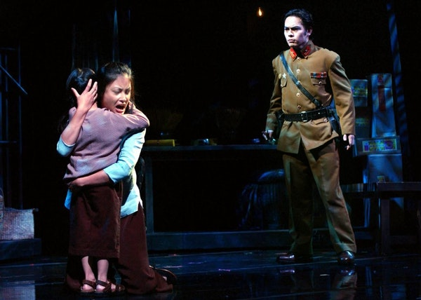 """Tam (Ashley Chan), Kim (Jennifer Hubilla) and Thuy (Bryan Geli in the number """"You Will Not Touch Him"""" from """"Miss Saigon."""""""