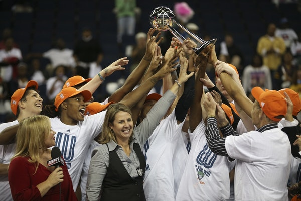 The Minnesota Lynx celebrate their victory over the Atlanta Dream after Game 3 of the WNBA finals on Thursday, October 10, 2013, at the Gwinnett Cente