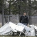 An FAA investigator examined the wreckage of a Cessna Sunday in Superior, Wis., a day after its pilot survived a midair collision with another plane.