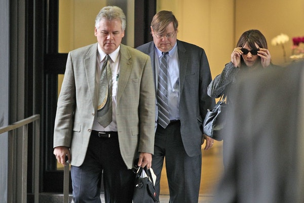 In this file photo, Frank Vennes, left, made his way out of the Federal Courthouse in St. Paul on Wednesday, June 5, 2013.