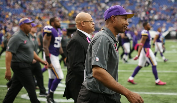 Vikings coach Leslie Frazier walked on the field after losing 35-10 to the Carolina Panthers.