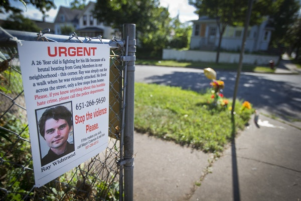 A memorial is set up, August 12, 2013, in the area of the Payne-Phalen neighborhood in St. Paul, Minnesota, where a brutal beating left a man with bra