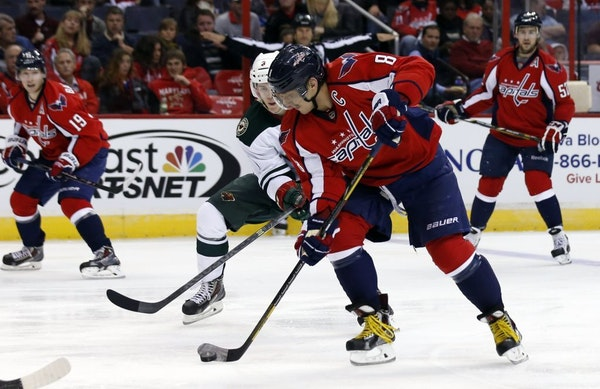 Minnesota Wild center Charlie Coyle (3) guards Washington Capitals right wing Alex Ovechkin (8), from Russia in the second period of an NHL hockey gam