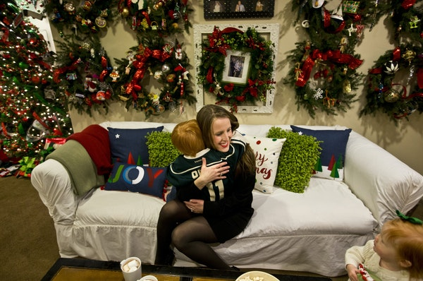 Bridget Connell was hugged by her four-year-old son Sam as daughter one-year-old Lauren stood nearby .