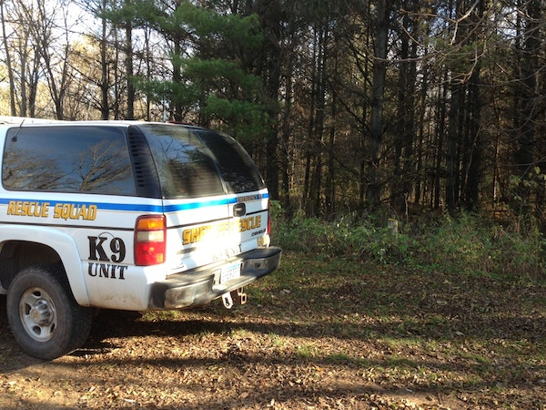 Authorities continued investigating the scene Oct. 27, 2013, where human remains were found near Sartell, Minn.