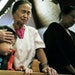 From top: At St. Paul's Wheelock United Methodist Church, Nicholas Moua, 6, top, prayed with his grandmother, Pang Hang. The Rev. Tsuchue Vang presi